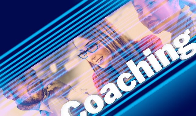 Three people smiling with the word coaching written at the bottom