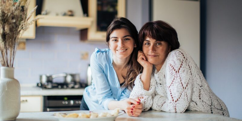 Mom and daughter smiling together and moving forward after a bad parenting moment