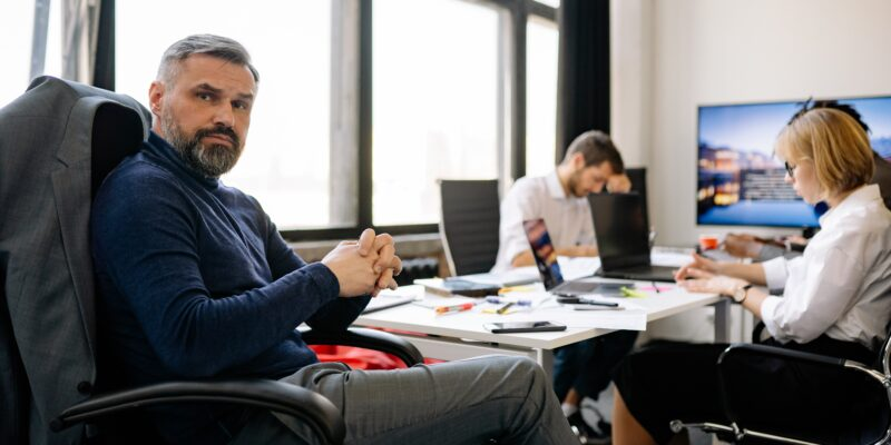 Businessman looking perplexed at work wondering how to cope with stress at work