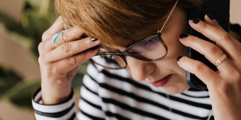 Anxious woman at work wondering how to be less stressed at work.